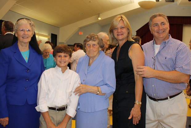 Sisters Marceline O'Connell and Imelda Moriarty were the last two Sisters at St. Catherine of Siena in New Orleans, teaching there 34 and 46 years, respectively. They were much loved by students, parents, and faculty. Pictured are Sr. Imelda (center) and Sr. Marceline with former students of the school, bidding them farewell in 2013.