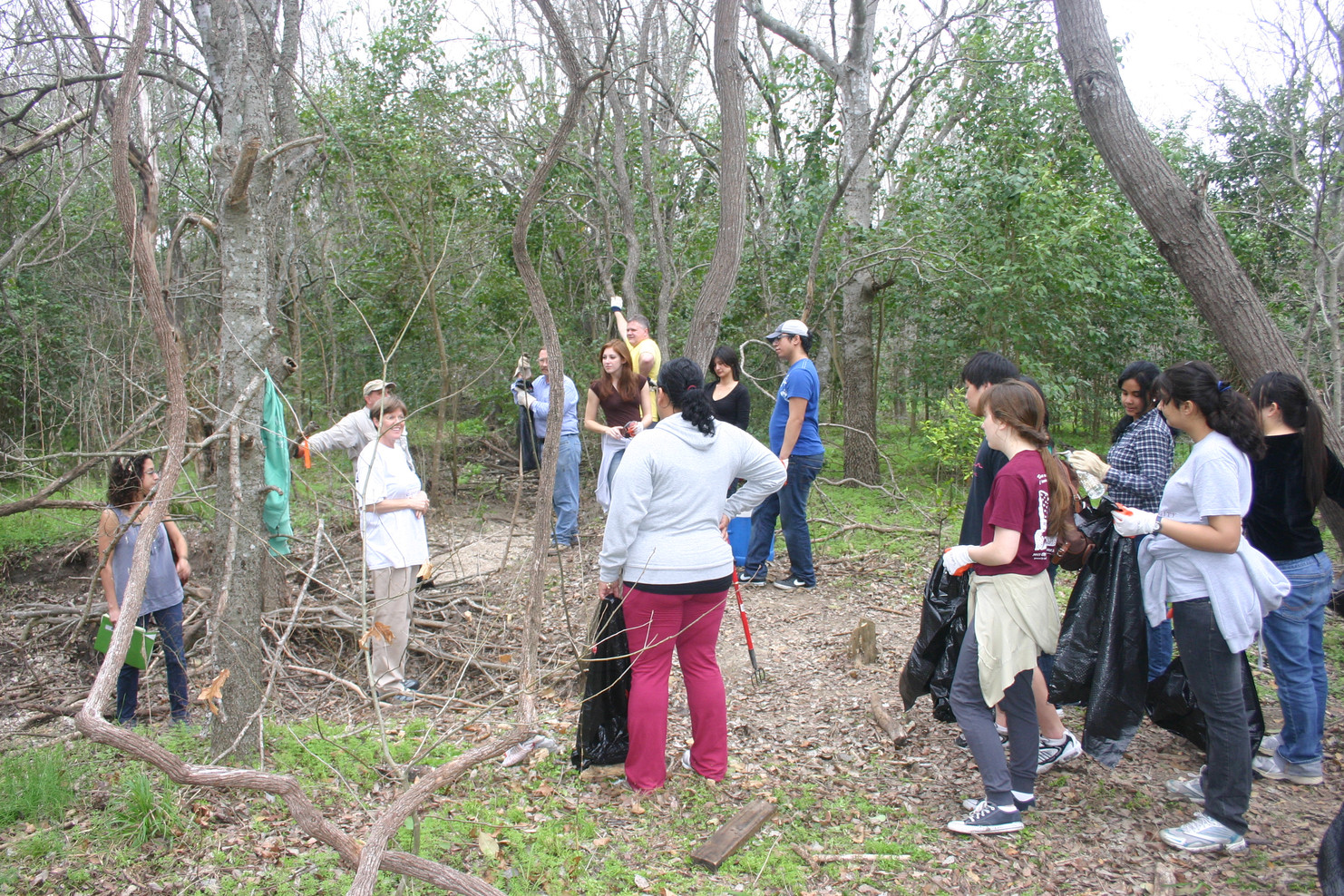 Volunteers help clear weeds on the Headwaters of the San Antonio River.