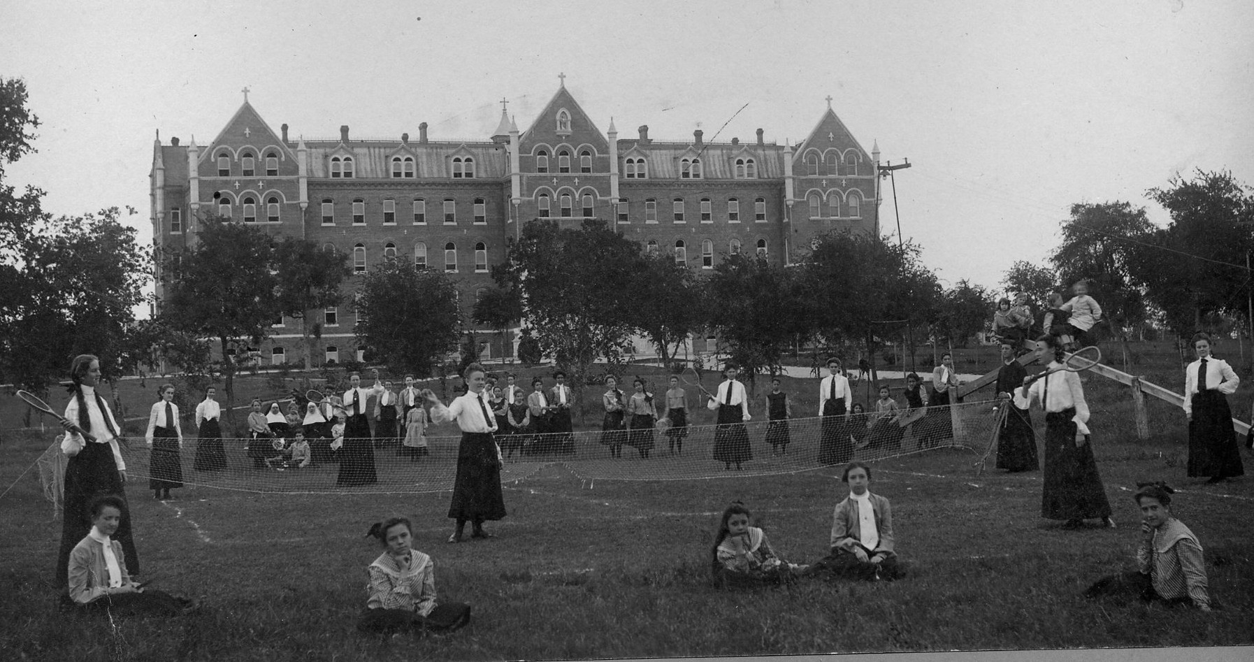 In 1909, Mother Mary John O'Shaughnessy proposed that Incarnate Word Academy be expanded to the college level, as women were not accepted at the colleges and universities conducted by men for men. College classes began in 1910. Photograph taken on the lawn in front of the Motherhouse / Academy.
