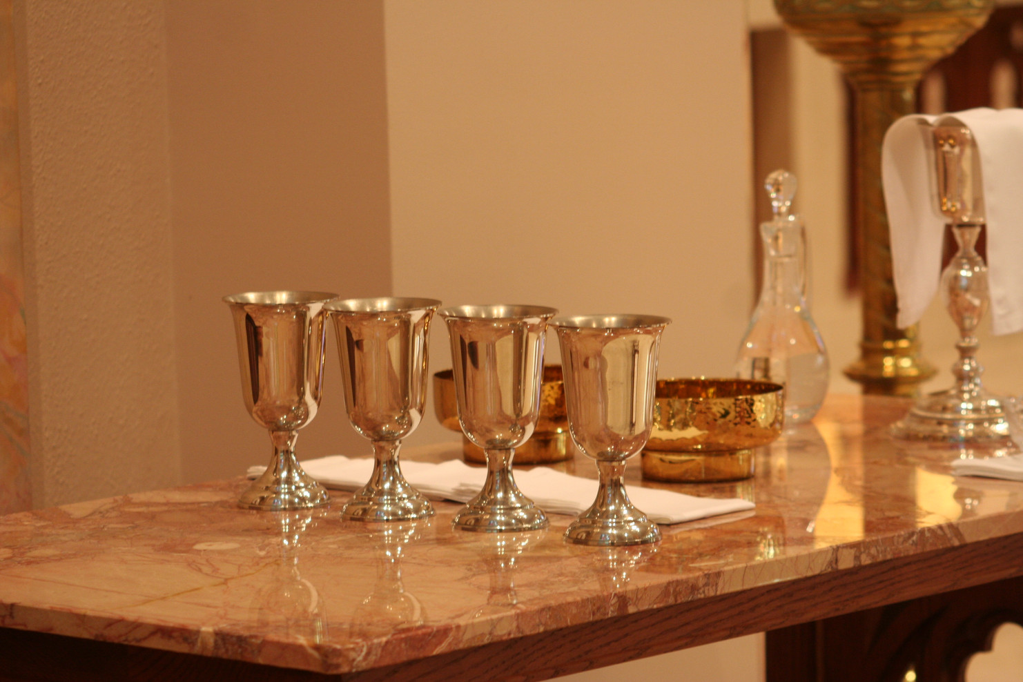 """The Eucharist is the """"source and summit"""" of our lives as Catholic Christians. We are called as Sisters to """"participate daily, when possible, in the Eucharistic celebration and sacramental life of the Church, entering more fully into the Paschal Mystery of the risen Christ."""""""