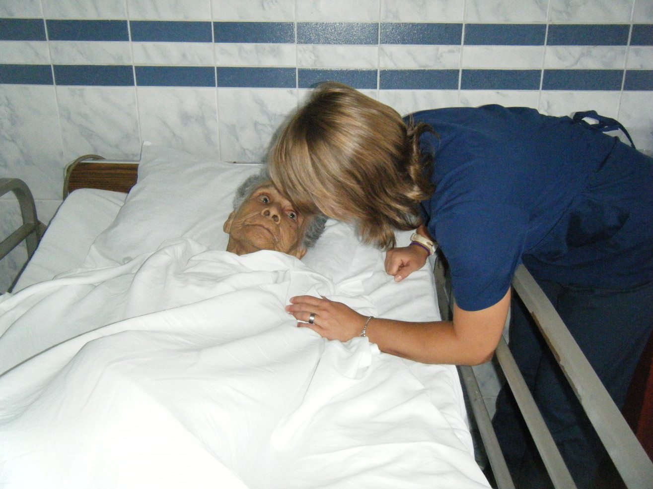 A patient is lovingly cared for at the Hospicio Santiago Apóstol in Chimbote, Peru, the first-known hospice in South America.
