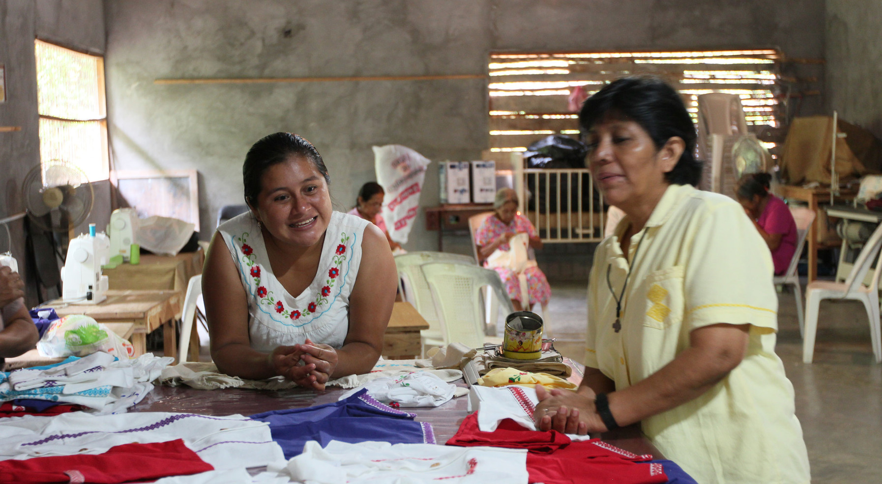 The Congregation established Cooperativade Mujeres Tampamolon, San Luis Potosí, to train indigenous women to do needlework that will enable them to produce garments and jewelry that can be marketed and sold. This enables them to provide for their families and gain some financial stability. Pictured is Sr. María Cardoso and one of the program's clients.