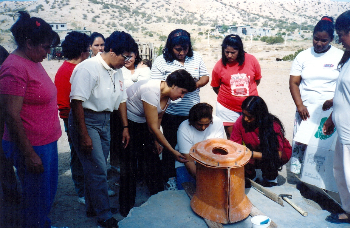 The Congregation founded Centro Mujeres Tonantzin, Juarez, in 1998 to lift migrant women out of the poor quarters in Ciudad Juarez. Sr. Petra Peña, second from left, works alongside other women, making their own composting toilets.
