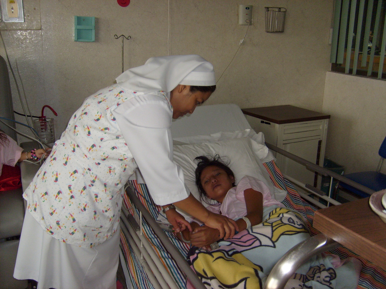 In Mexico, Sisters still work in hospitals and clinics. Here, Sr. Ángela Hernández Sánchez tends to a young patient at the Instituto Nacional de Cardiología.
