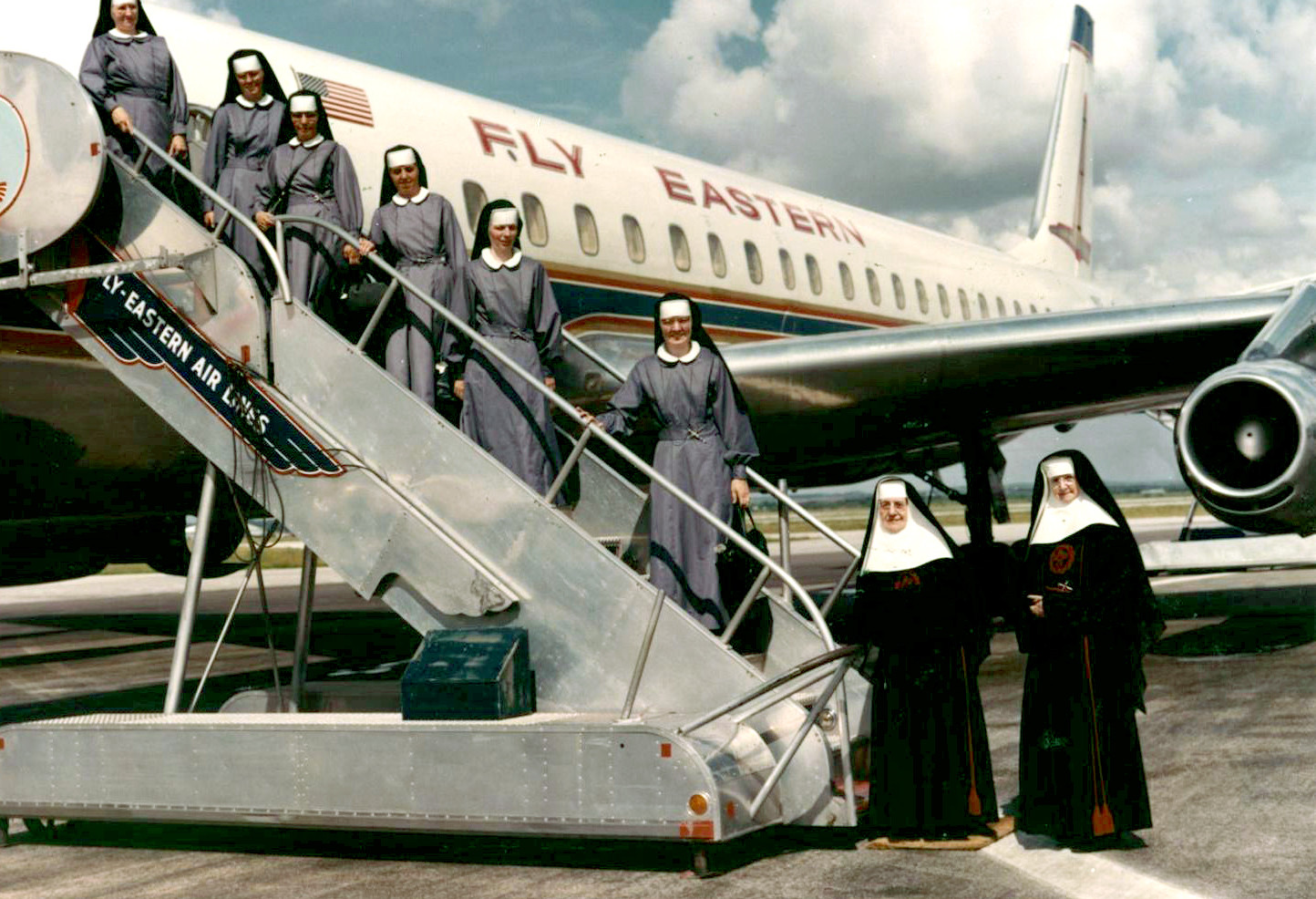 In 1964, in response to an appeal from the Church, six Sisters left San Antonio for Chimbote, Peru. Pictured in a special gray habit are Sisters Charles Marie Frank, Mary Mark Gerken, Maria Felicitas Villegas, Rosalina Acosta, Louis Katharine Schuler, and Gwendolyn Grothoff. Mothers Mary Clare Cronly and Mary Calvary Le Page accompanied the Sisters to the airport.