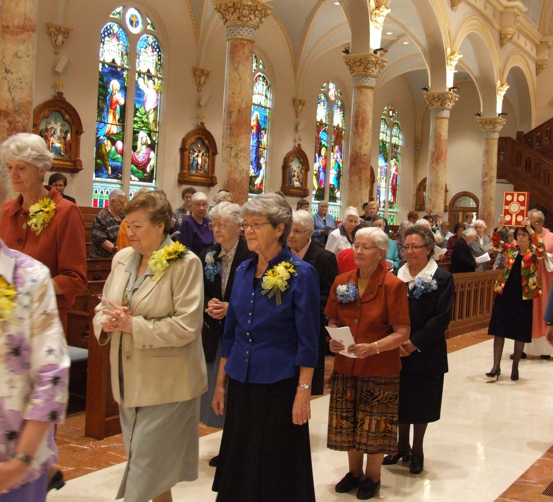 At the Congregational Jubilee celebration in 2011, Sisters wearing gold corsages are celebrating 50 years; blue signifies 60 years.
