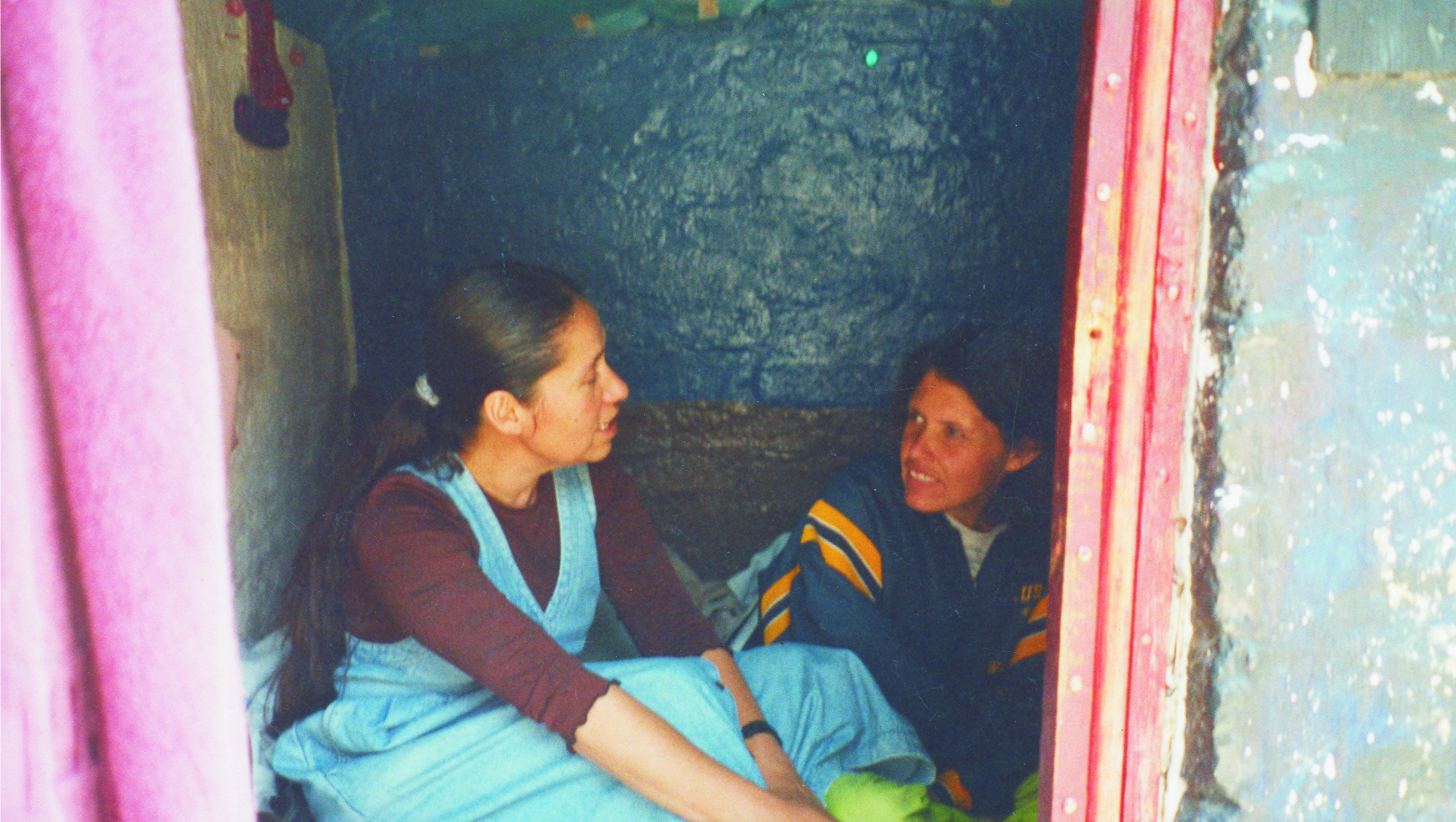 In 1973, Sisters in Mexico started a new form of ministry called Pastoral Popular. Sisters sought out, lived with, and ministered to the underserved, focusing on daily contact with the people at their work and in their homes. Here, Sr. Ofelia Lozano visits a parishioner in Mexico City.