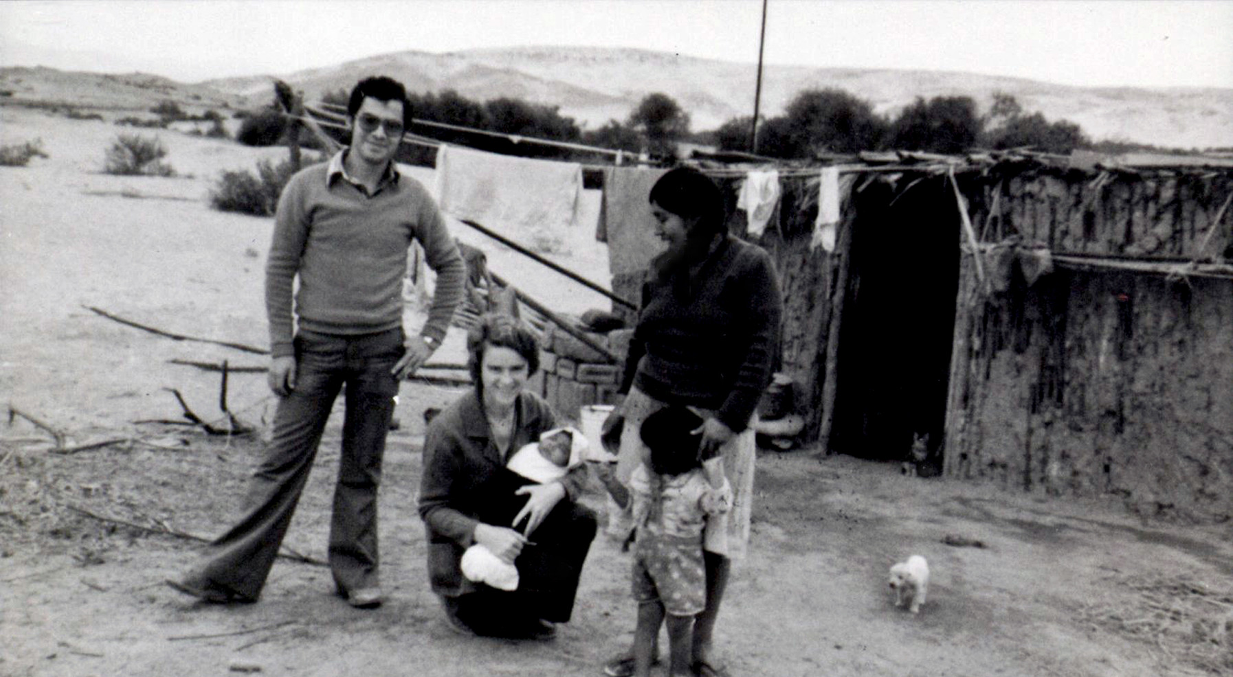 In 1981, three Sisters opened a mission in Cambio Puente, Peru, where they worked with exploited campesinos on the outskirts of Chimbote. Sr. Rosaleen Harold (pictured holding a baby) was one of the three Sisters who went to Cambio Puente. Sr. Rosaleen served in Peru for more than 30 years.