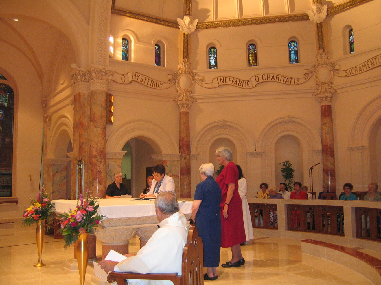 Pictured is Sr. Mary Henry signing her final vows (2006), witnessed by Srs. Peggy Bonnot, Helena Monohan, Bette Bluhm, and Eleanor Geever.