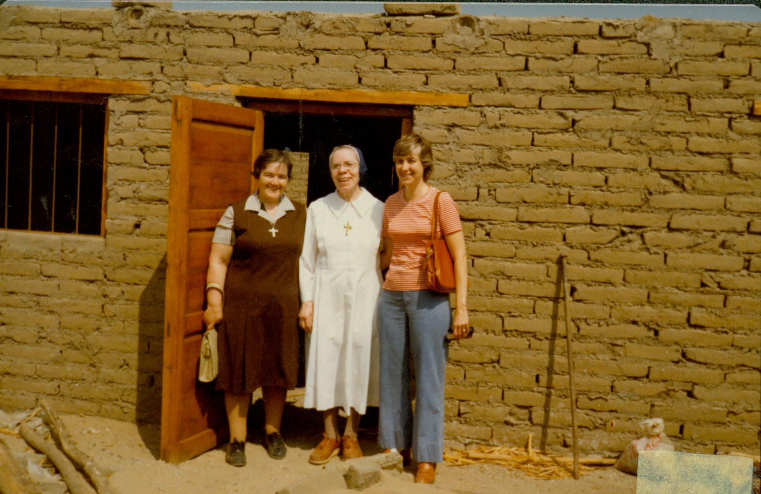 Sr. Louise Mair (center) worked for many years as a cook at the Provincial House in St. Louis, Missouri. She later served in Cambio Puente, Peru, living in a simple house the Sisters built themselves.  Sr. Louise baked bread to share with her neighbors; she was very much loved by the people of Cambio Puente.