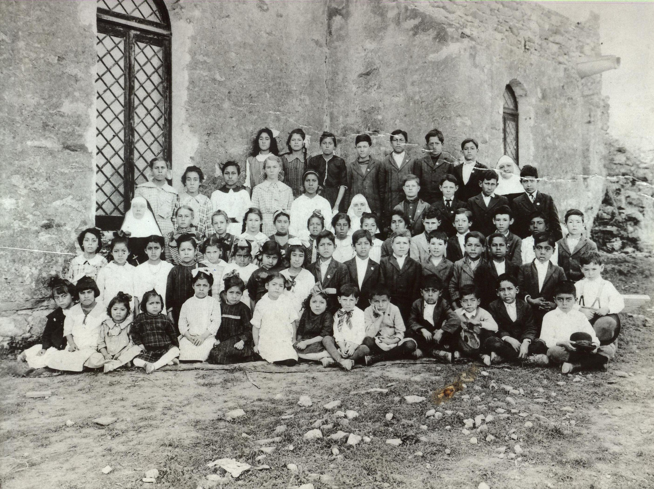 In 1875, Incarnate Word Sisters began teaching in public and private schools. By the early 1920s, Incarnate Word Sisters were teaching in more than 30 public and parochial (parish) schools in Texas, Missouri, and Oklahoma.  (pictured: School at Mission Espada, San Antonio, 1916)