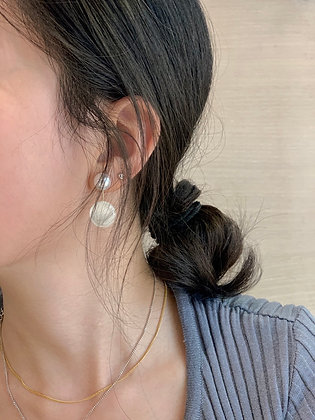 asymmetrical pearly stone earrings