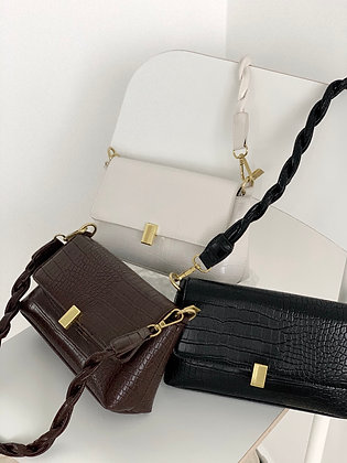 twisted handle shoulder bag