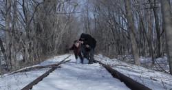 The Avenue - Eddie and Nicholas on train tracks