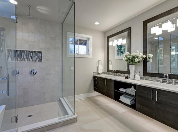 Spacious bathroom in gray tones with hea