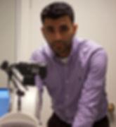 Ali Walji, Optometrist with a retinal camera