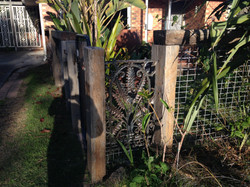 Fence with wrought iron feature
