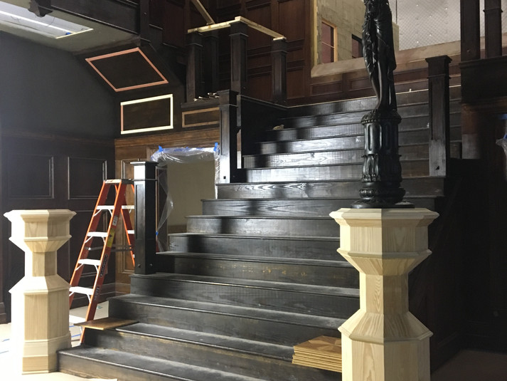 Grand Stairs newel posts with Lady Lamp