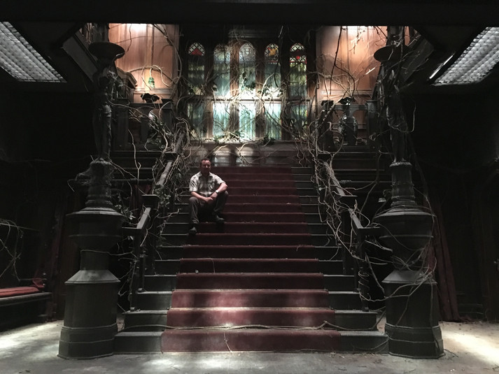 """Grand Stairs dressed for the """"decades of neglect"""" scene"""