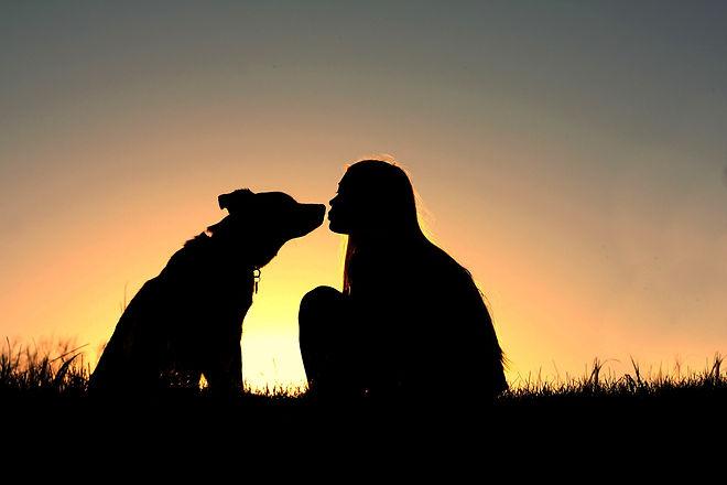 girl kissing dog.jpg