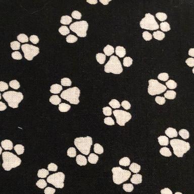 White Paw Prints on Black