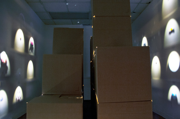 Kyoko Hamaguchi, Invisible Cities, 2019, 20 cardboard boxes 3'x 3'x 3' each, 20 LED lights, various objects, Final installation dimensions variable