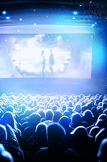 Audience in the theater in front of the screen