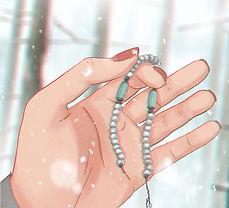 A broken bracelet on a palm of a hand.