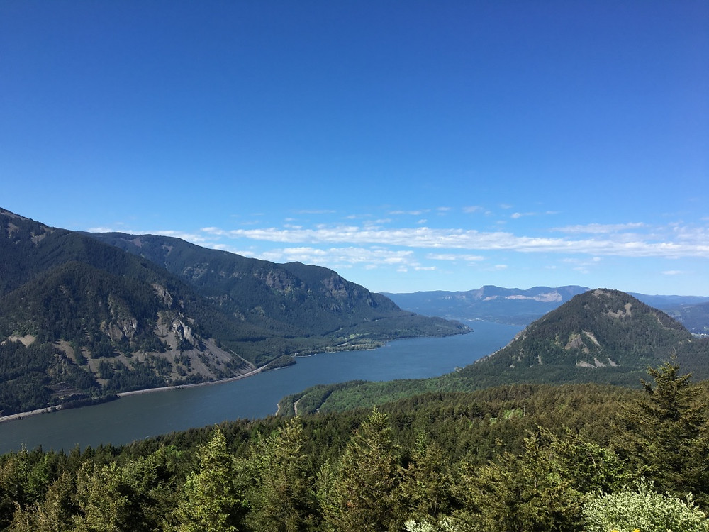 Mountainous landscape in the US Pacific Northwest with a river running through the middle. a