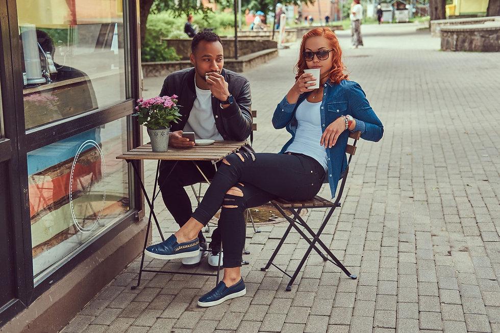a-couple-dating-drinking-coffee-sitting-near-the-c-QWYVBEJ-scaled.jpg