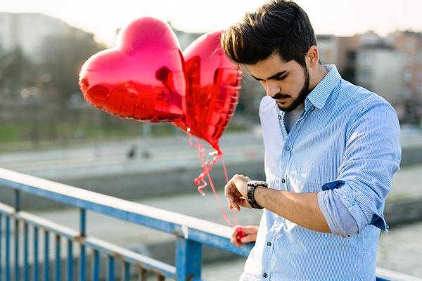 sad-man-waiting-for-date-on-valentine-date-N6Y5R7C-scaled.jpg