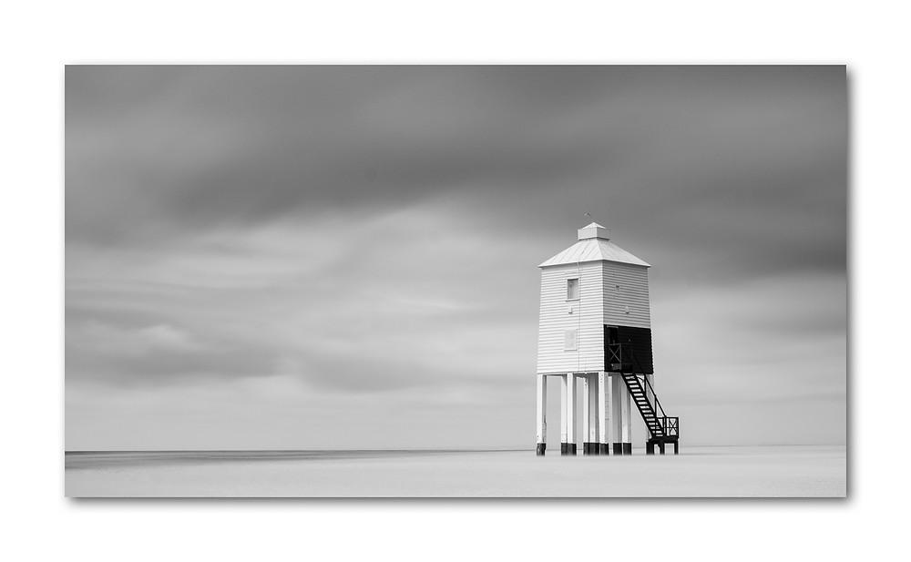 Lighthouse on a bleak windswept beach