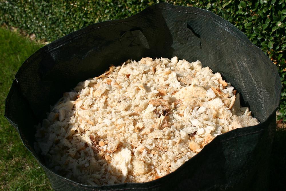 20L gardening bag full of chopped up bread