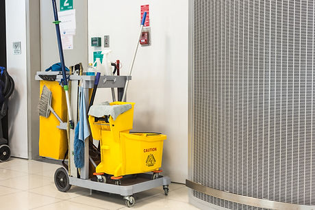 Yellow Mop Bucket And Set Of Cleaning Equipment.jpg