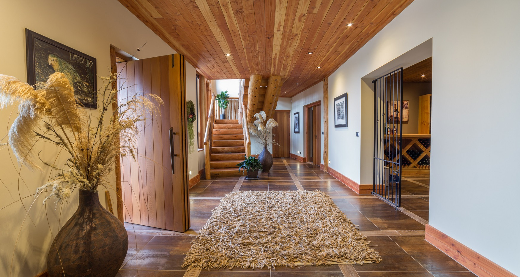 Fiordland Lodge entry and wine cellar