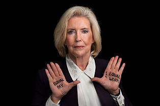 """Equal Pay for Equal Work"" written across Lilly Ledbetter's hands"