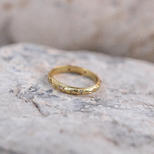 Faceted Gold Band with diamonds