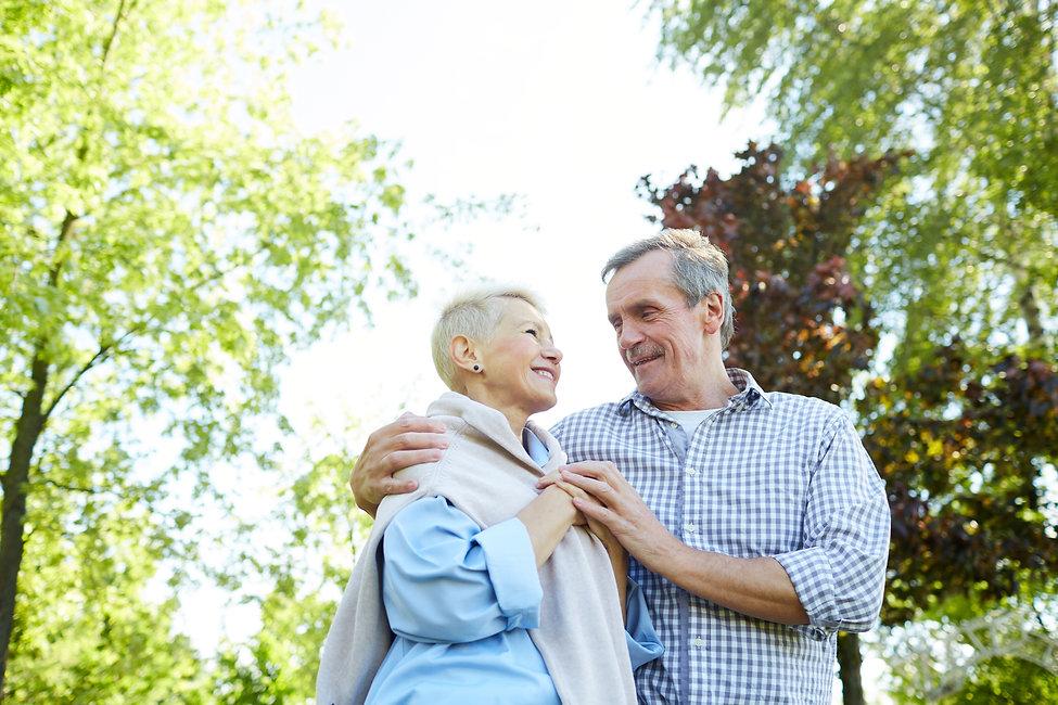 senior-couple-walking-in-park-E9J4BF2.jpg