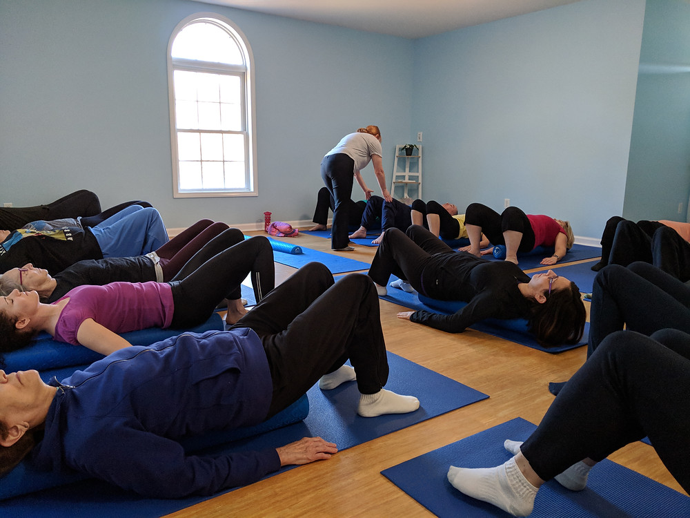 Sandy Brady teaching MELT Foam Rolling to beginners at The Studio at A Step To Health at our open house in Hillsborough, NC.