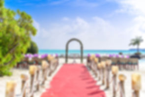 beach-wedding-event-under-white-clouds-a