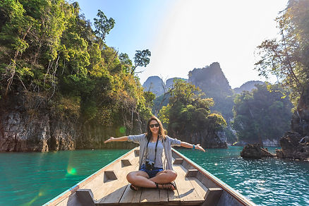 photo-of-woman-sitting-on-boat-spreading