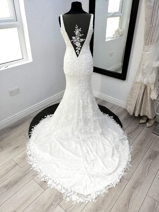 Trumpet style open back wedding dress with bustle