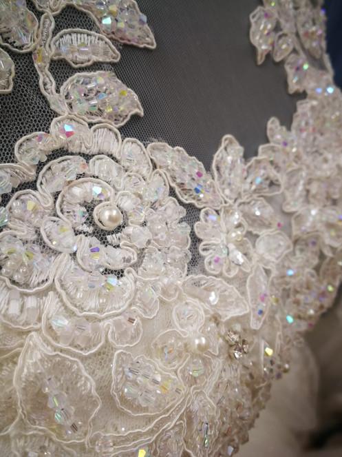 Close up of hand embellishing and beading