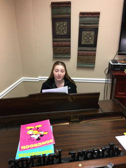 young lady playing piano