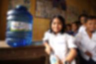 Children in class with jug - Amandine Mu