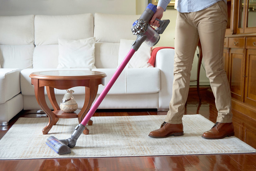 Man running a cordless vacuum cleaner ac