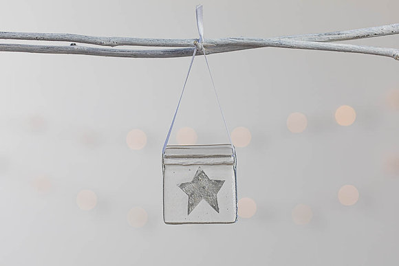 The hanging, grey and silver glass star