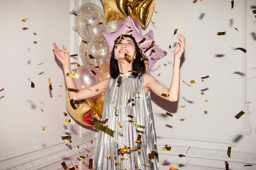 woman-looking-at-falling-confetti-341969