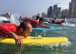 paddling to waves- surf lesson