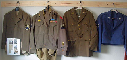 military_uniforms_hanging_on_display[1].